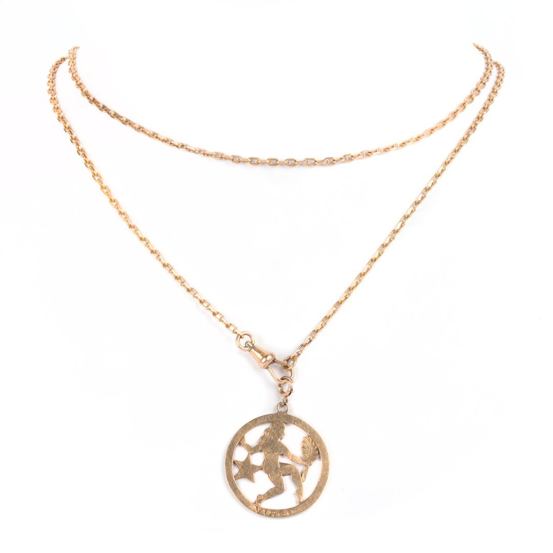 A 14K Gold Virgo Pendant and Oval Link Chain