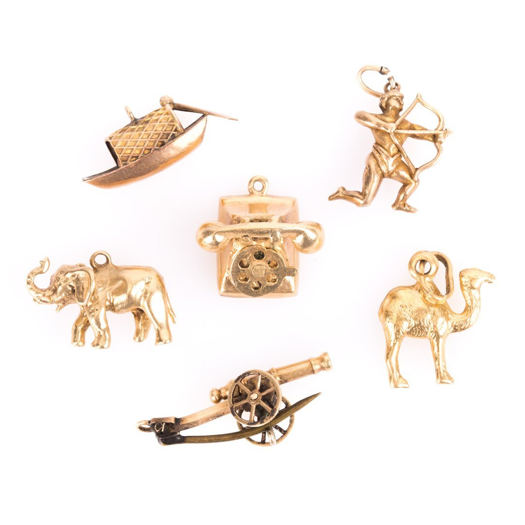 Five Gold Charms and Pin in Gold