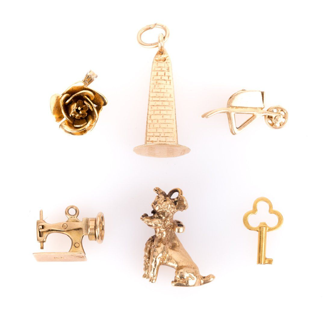 A Collection of 14K Gold Charms