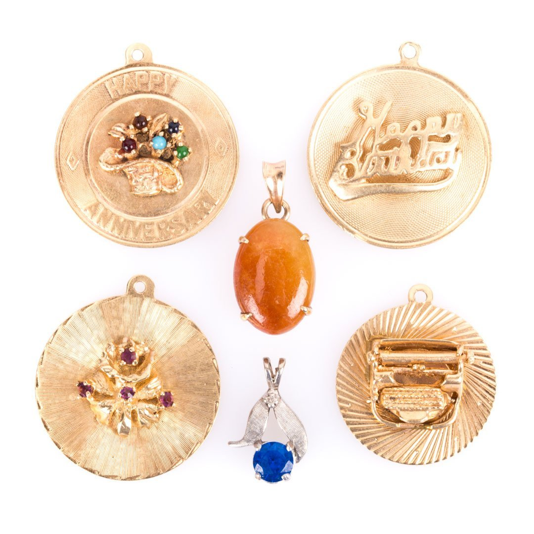 A Group of Charms and Two Pendants for a Lady
