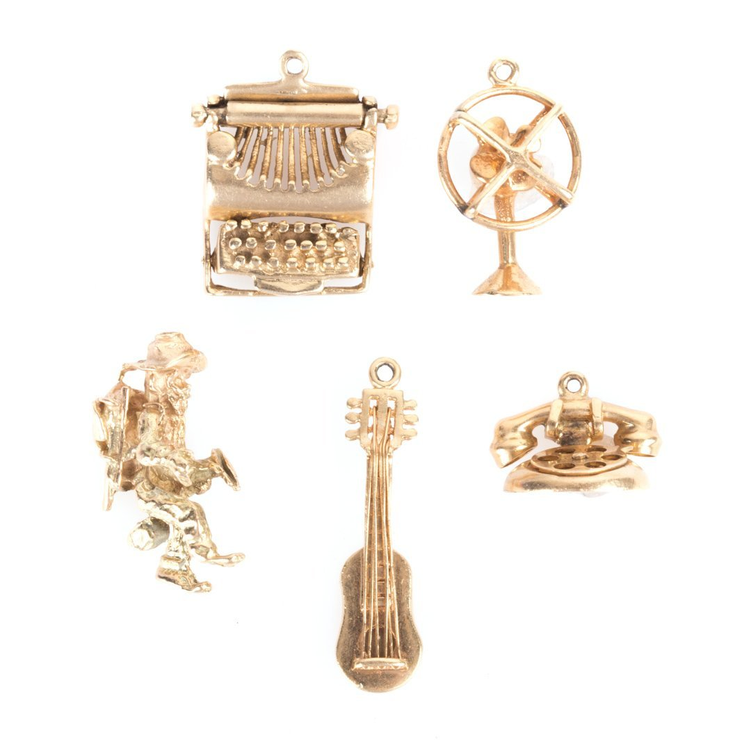 A Selection of 14K Gold Charms
