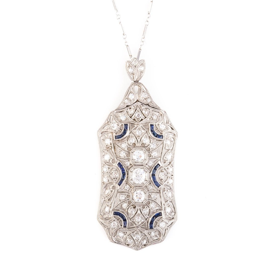 An Art Deco Platinum Diamond and Sapphire Pendant