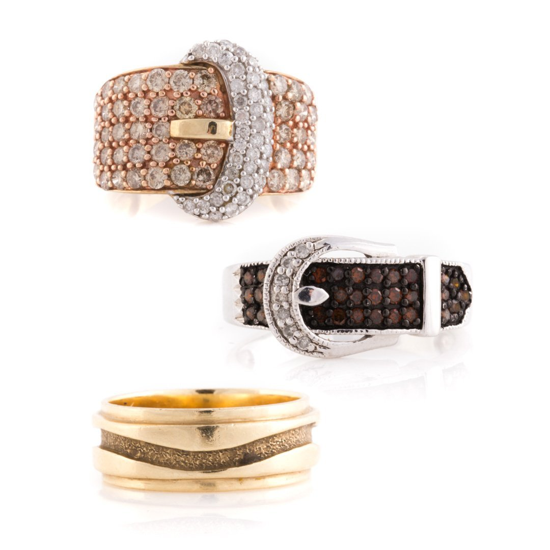 """A Pair of Diamond """"Buckle"""" Rings & 14K Gold Band"""
