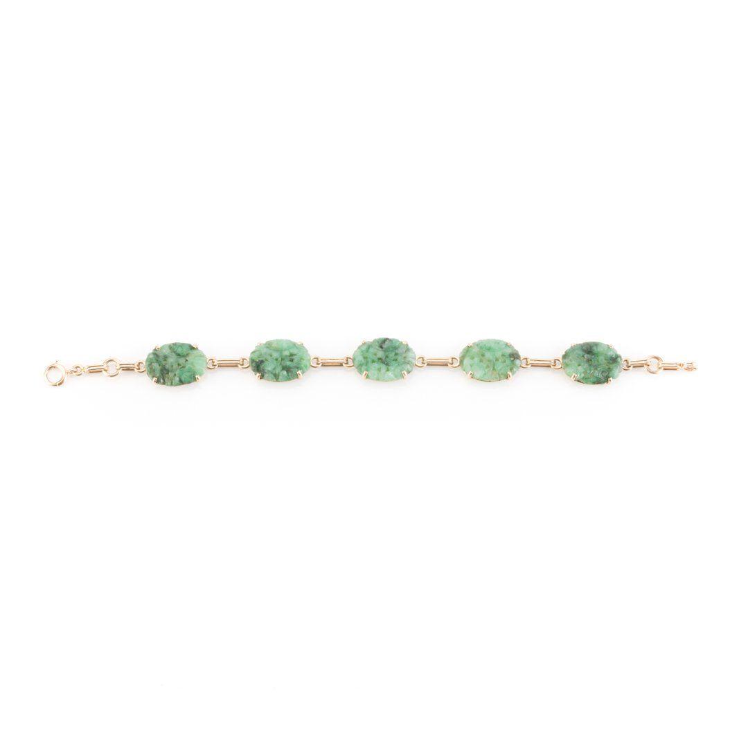 A Carved Jade Oval Link Bracelet in 14K Gold