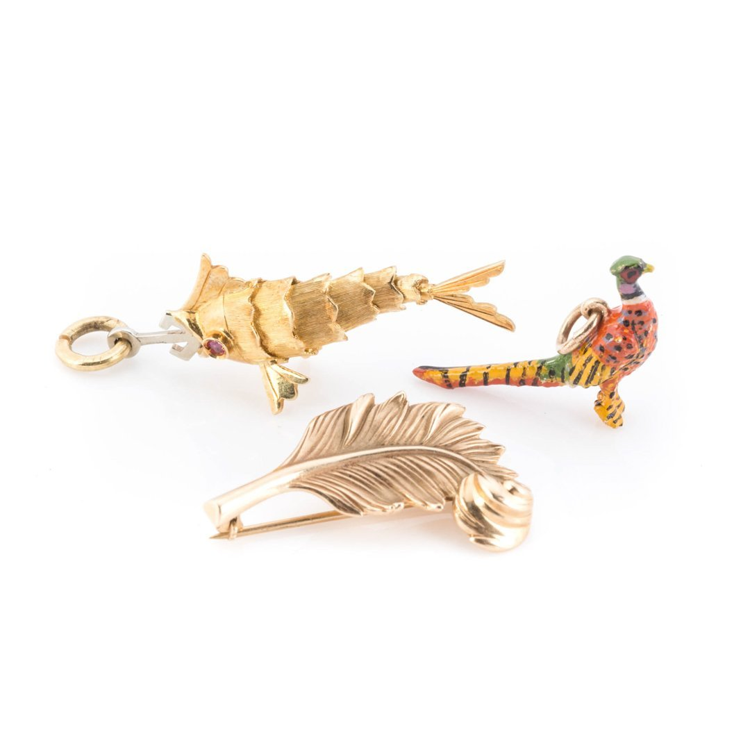 A Pair of Hunting Charms with Gold Pin
