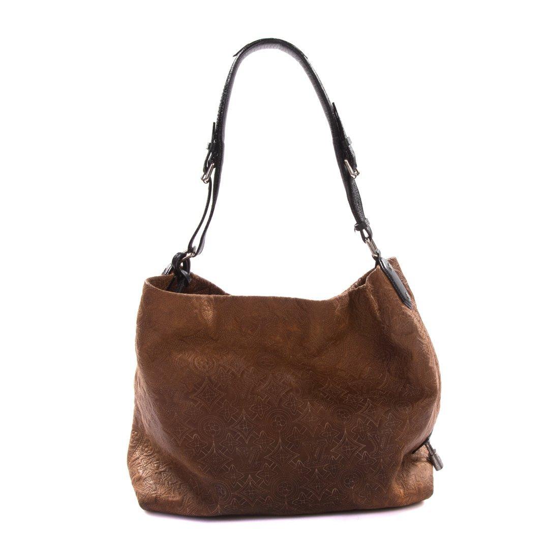A Louis Vuitton Artsy MM Handbag - 2