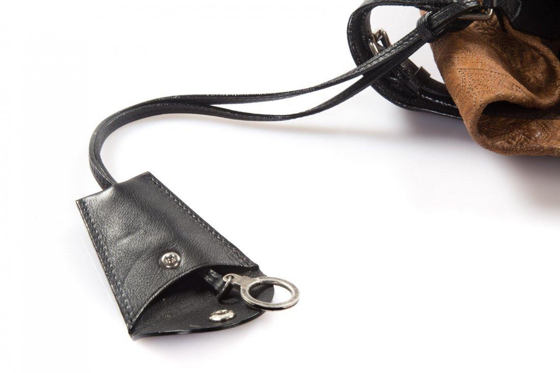 A Louis Vuitton Artsy MM Handbag - 8