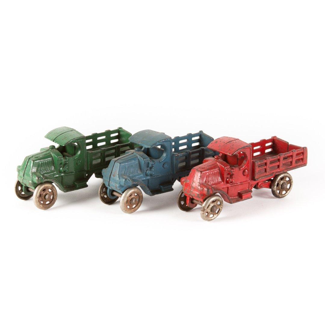 Three arcade or Hubley stake trucks