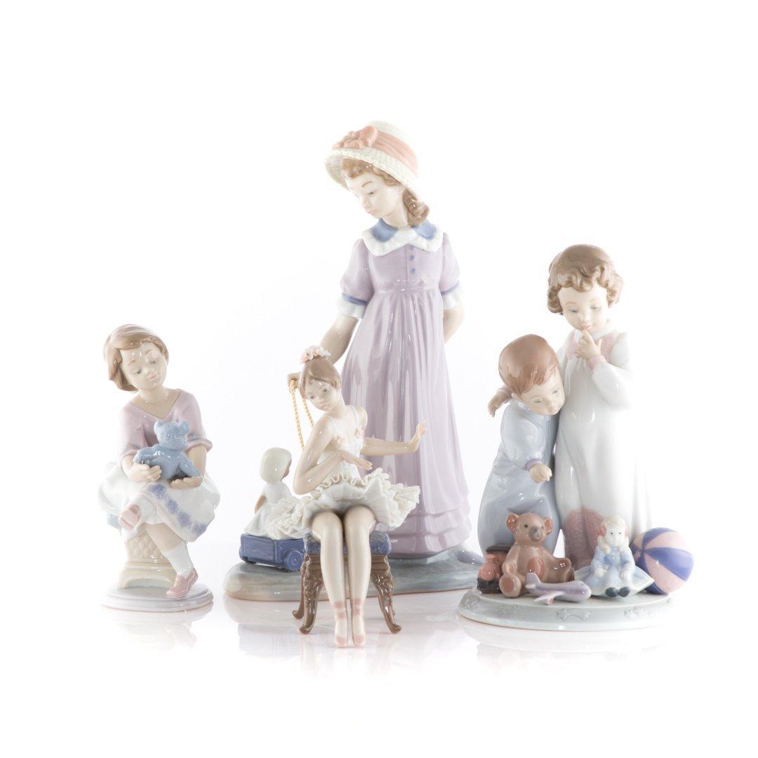 Four Lladro porcelain figures