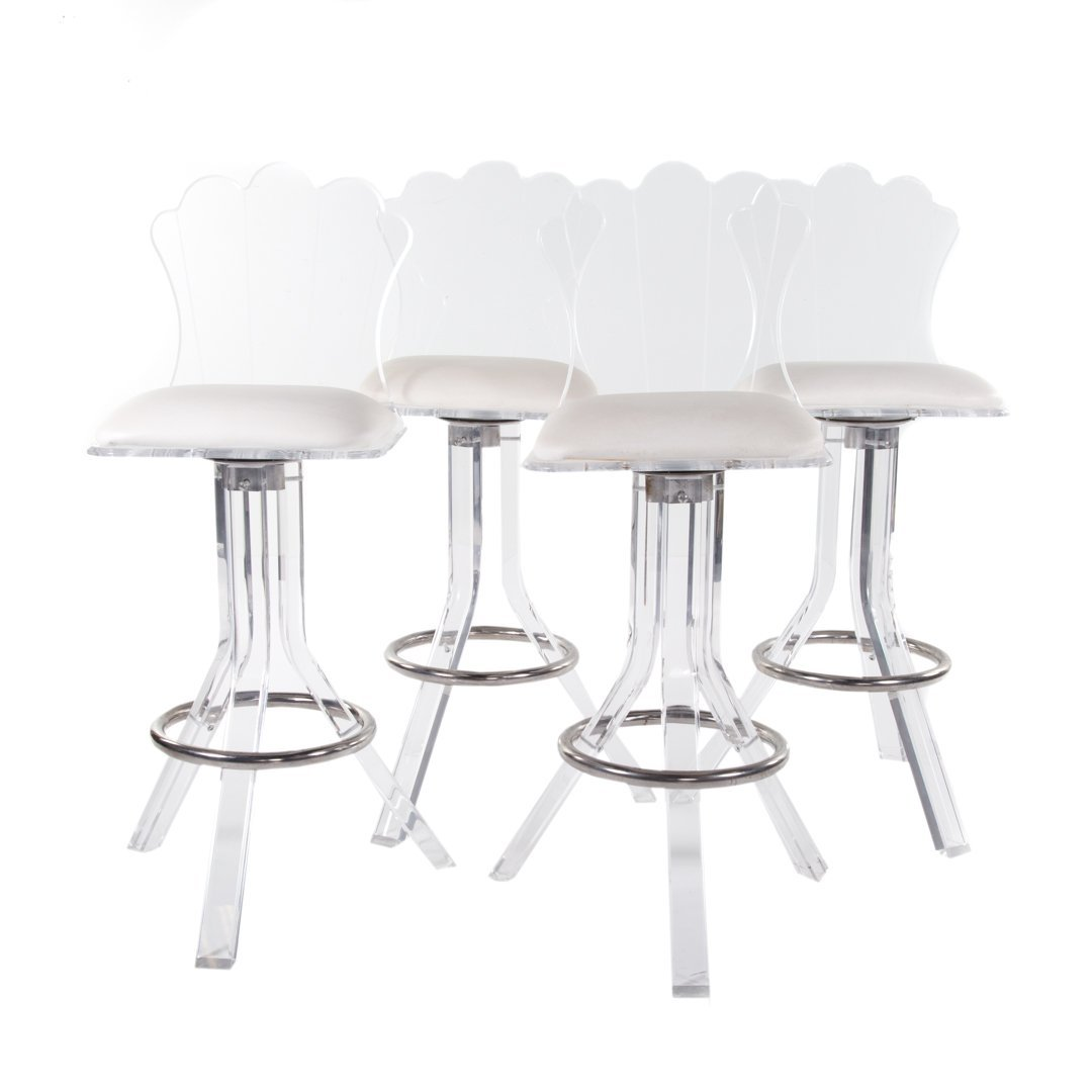 Four lucite and chrome counter stools