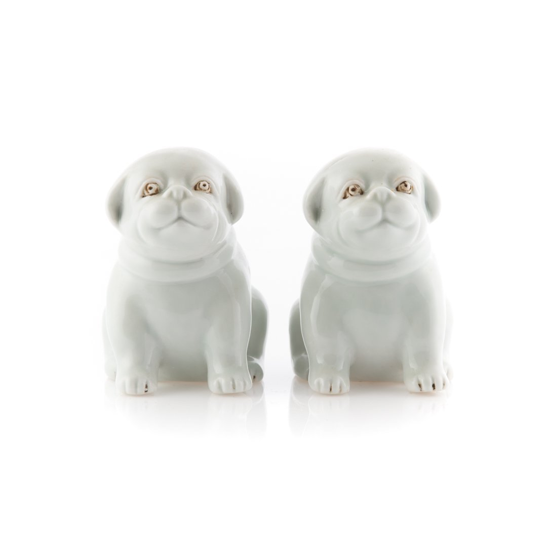 Pair Chinese Export Blanc de Chine porcelain dogs
