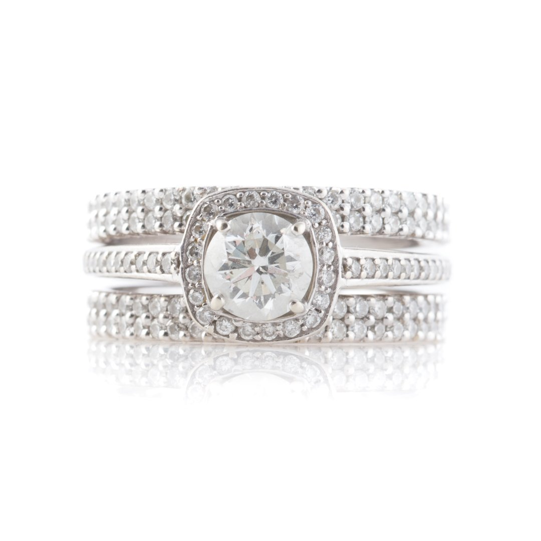 A Diamond Engagement Ring & Two Diamond Bands