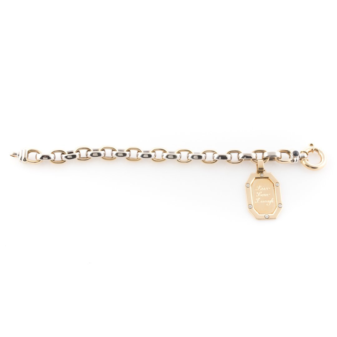 A Link Bracelet in 14K with an 18K Gold Charm - 2