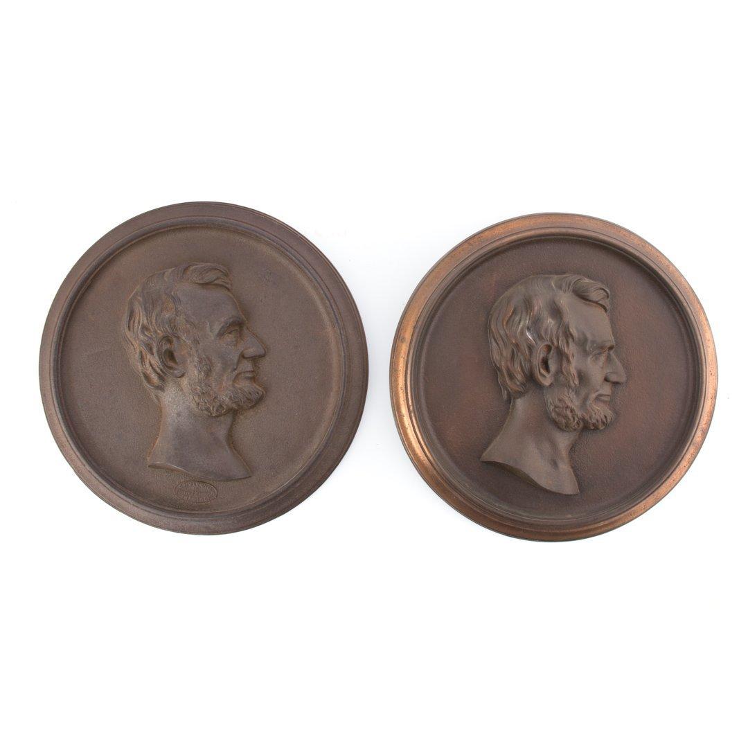 Two variant portrait plaques