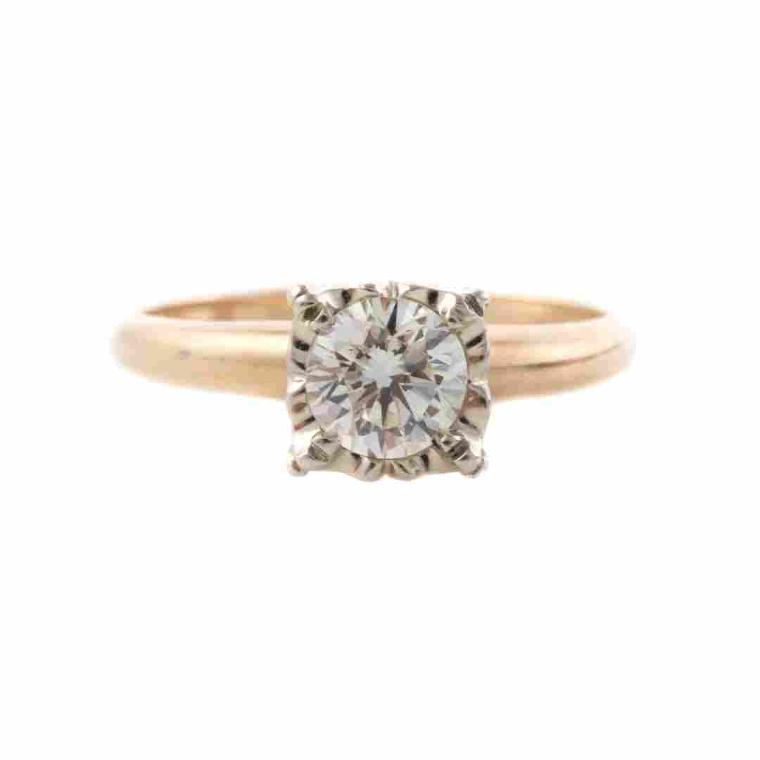 A Lady's Diamond Solitaire Ring in Mystery Setting