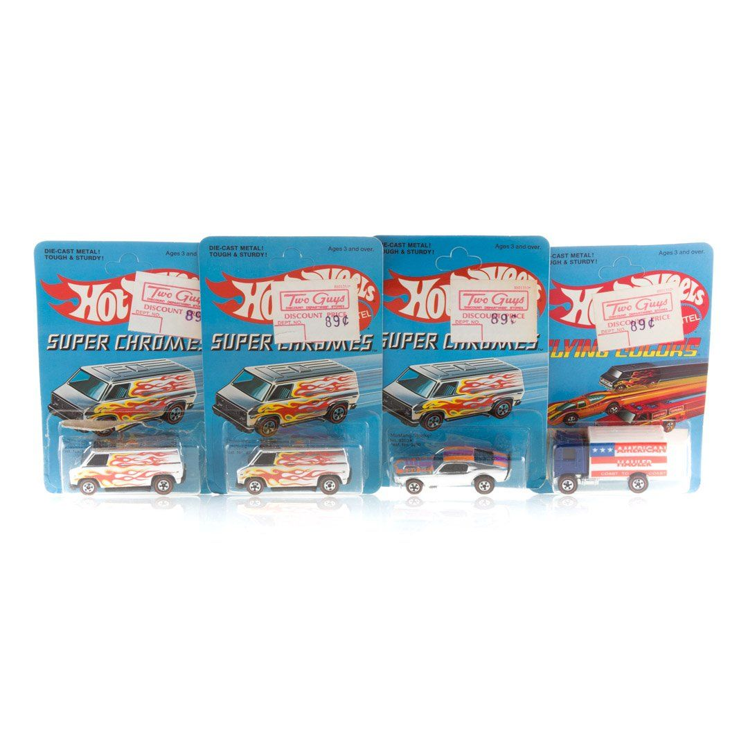 Four Hot Wheels Red Line vehicles