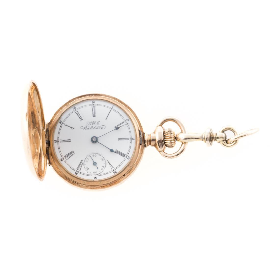 A Lady's 14K Waltham Pocket Watch with Hunter Case