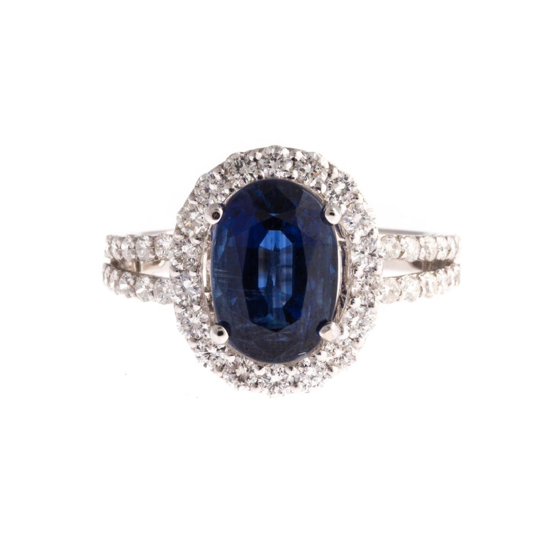 A Lady's Sapphire and Diamond Ring in 18K