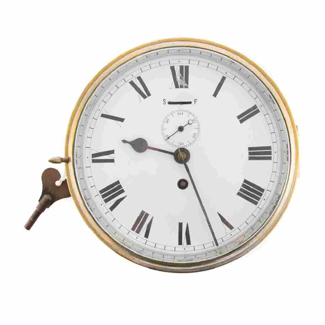 Brass porthole ship's clock