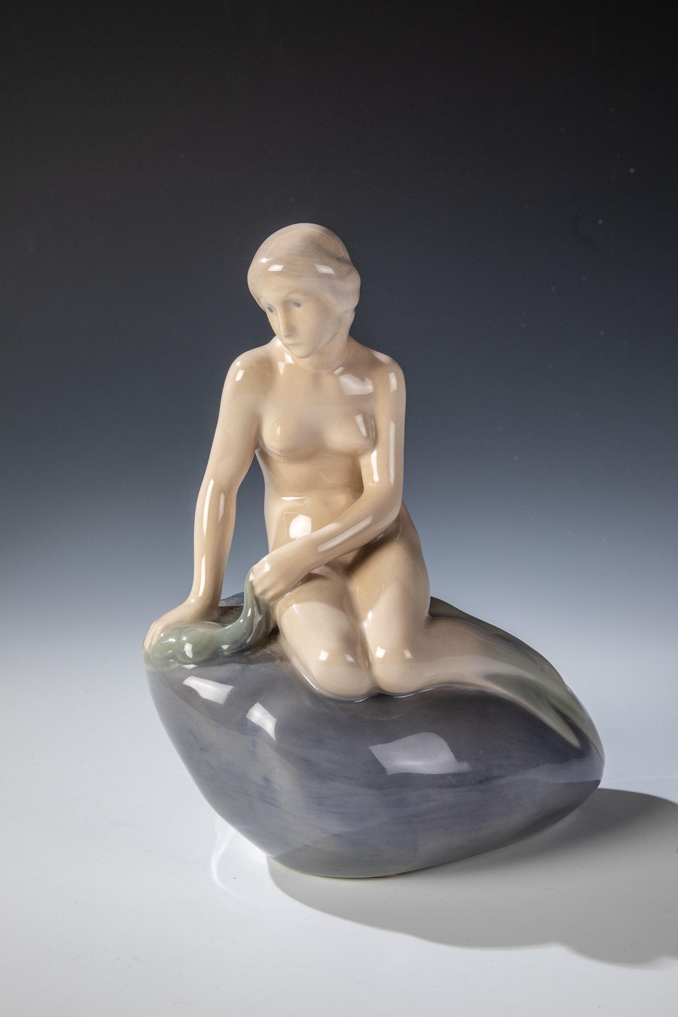 Meerjungfrau auf Felsen