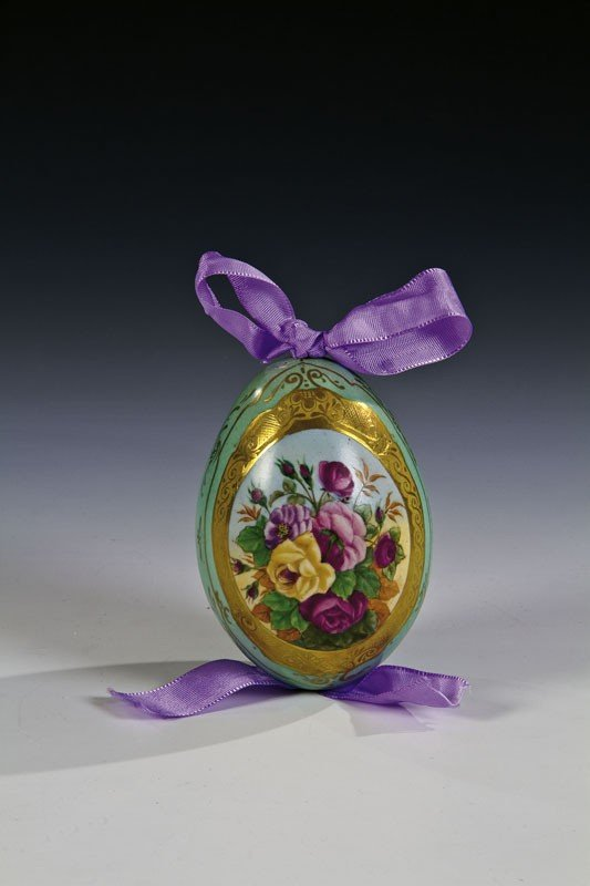 4: A porcelain Easter egg decorated with a multi-colour