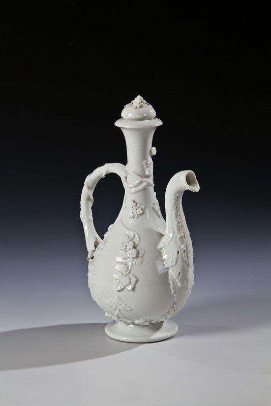 5: A porcelain decanter with stopper. The body and the