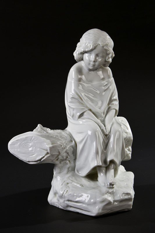 6: A porcelain figure of a young maiden sitting on a bo