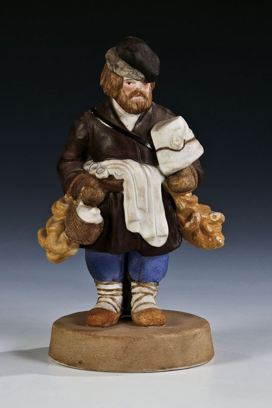 7: A biscuit porcelain figure of a bread seller. Painte