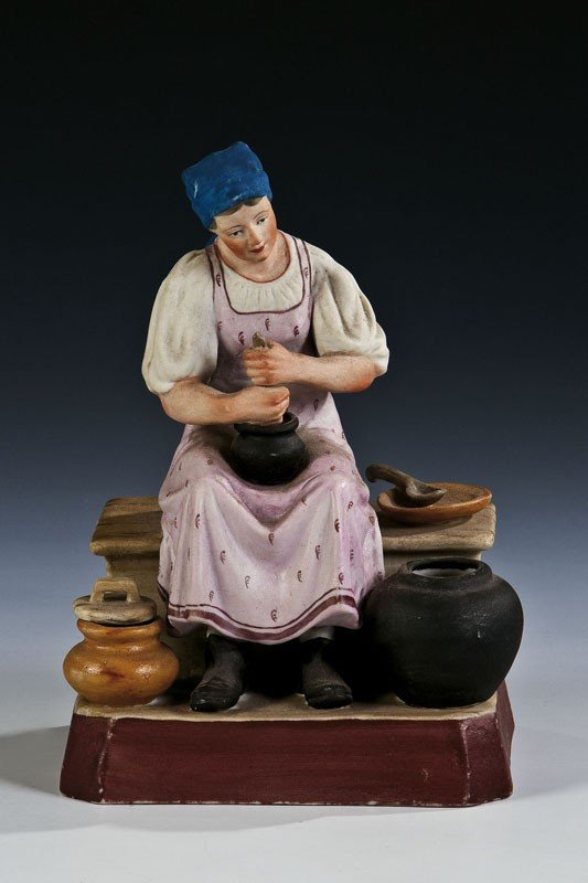 8: A biscuit porcelain figure of a peasant woman prepar