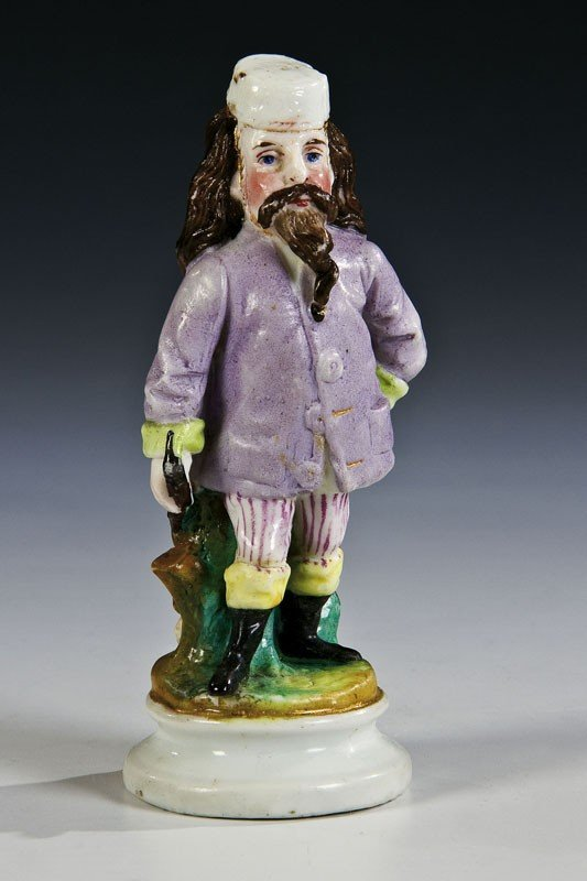 9: A porcelain figure of a smoker. Marked under base wi