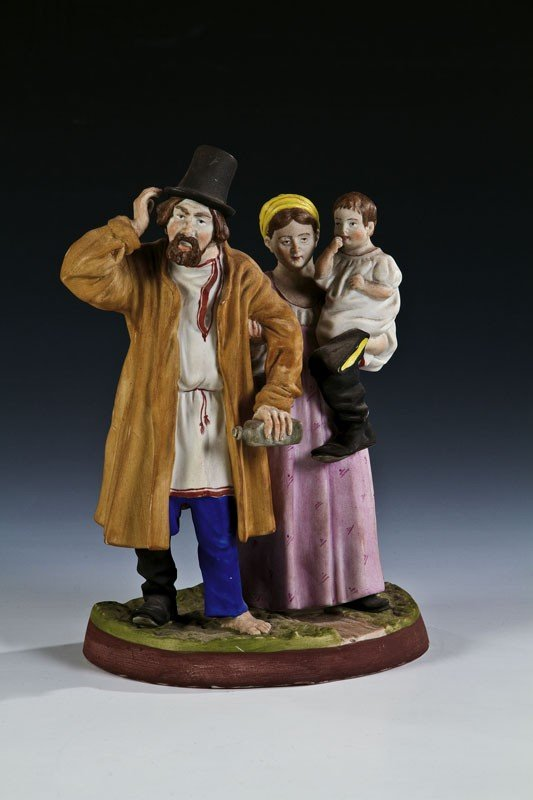 10: A biscuit porcelain figure of a Russian peasant fam