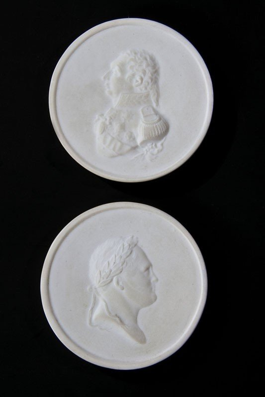 13: A pair of biscuit porcelain plaques showing the por