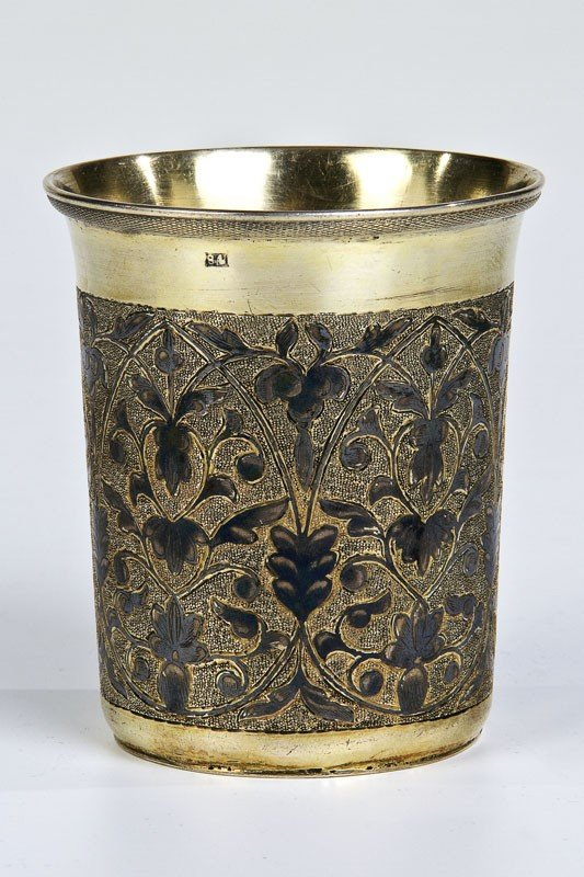 20: A silver-gilt and niello beaker decorated with scro