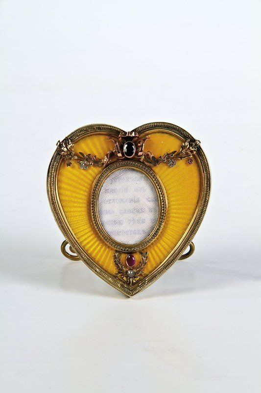 365: A hear-shaped photo frame decorated with yellow tr
