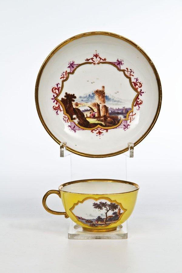 16: Tasse und Untertasse mit Kauffahrteiszenen