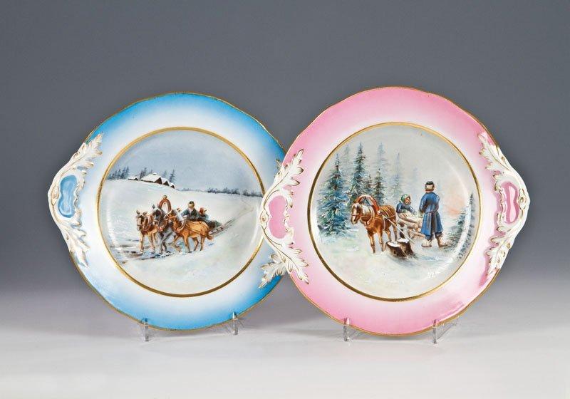 Paar Teller mit winterlichen Szenen