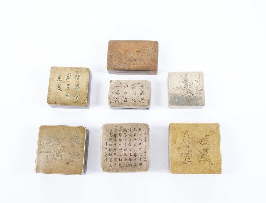 Sammlung von sieben Tuschegefäßen