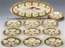Limoges Fish Set  12 plates plus platter artist