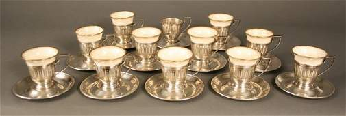 219 Twelve Gorham sterling holders and saucers Lenox