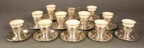219: Twelve Gorham sterling holders and saucers, Lenox