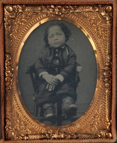18: tintype of a young Mulatto child in a chair
