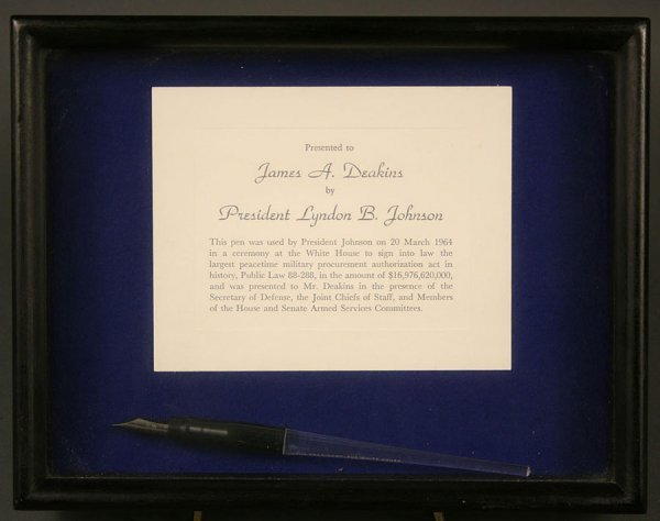 337: President Johnson signing pen with certificate