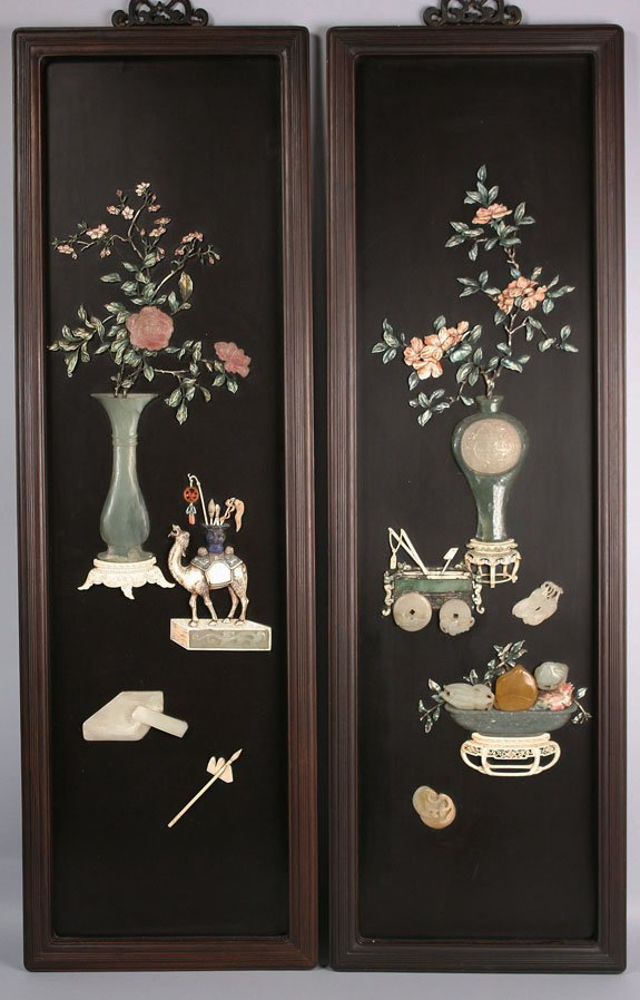 122: Pair of Oriental carved panels