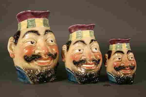 321: Majolica bearded face pitchers, 3 pieces