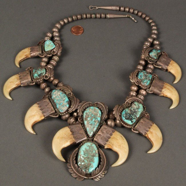 165: Native American silver and turquoise claw necklace