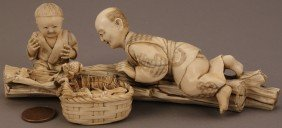 12: Ivory Okimono figure, boy and father with frogs