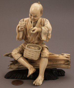 13: Ivory Okimono figure, man smoking a pipe