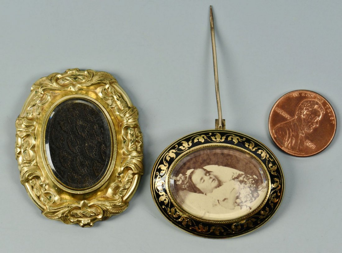 2 Mourning Brooches , one 14k with child in casket