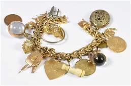 14K Charm Bracelet, drum, heart, horseshoe, etc.