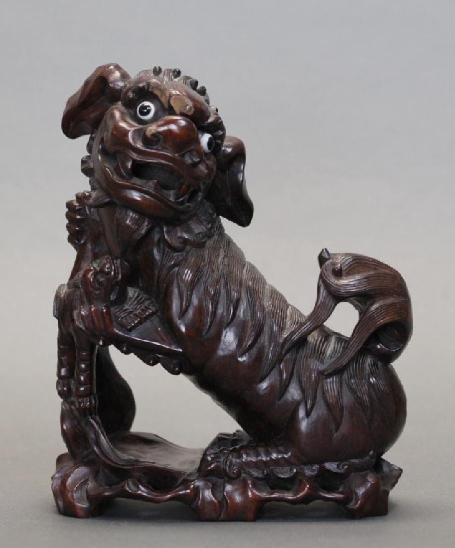 Chinese hardwood carving of a lion holding her cub